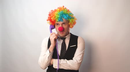 fool : Office worker in clown wig, clown concept at work. Businessman with clown wig isolated on white