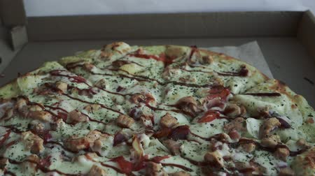 salam : Close-up of pizza, in a cardboard box above the table. Pizza delivery, menu. Fast food, crusty dough