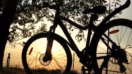bikers : Beautiful close up scene of bicycle at sunset