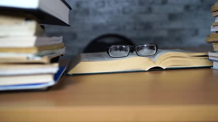 irodalom : Open book and glasses on Desk in office or library. Learning concepts