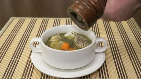 peper : Black pepper is added to the Macrourus fish soup Stock Footage