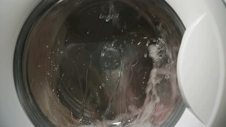 lave : Internal view of washing machine drum during wash Stock Footage