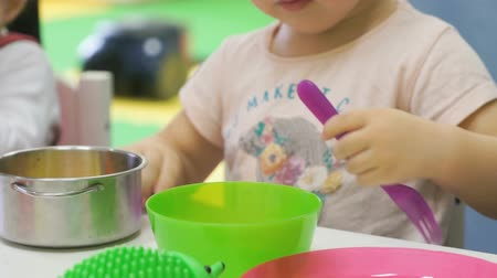 plastics : Kids playing with plastic childrens tableware