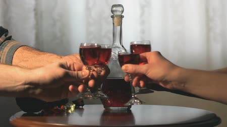 tincture : Four friends hold glasses with cranberry tincture