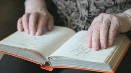 adresář : Old hands of the old woman holding a book