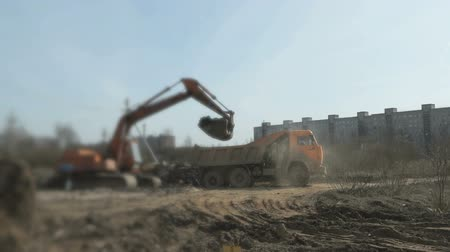 guba : Excavator loading clay into the dump truck