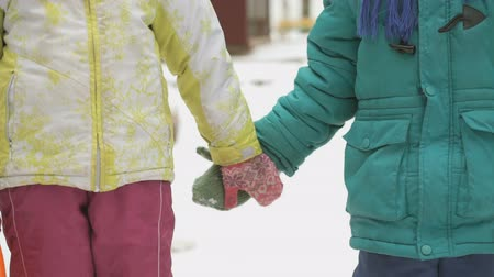 сестра : Little boy and girl holding hands friendly