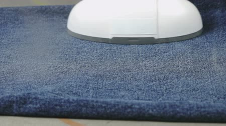 crinkle : The woman soars the jeans using the steam cleaner. Close up Stock Footage