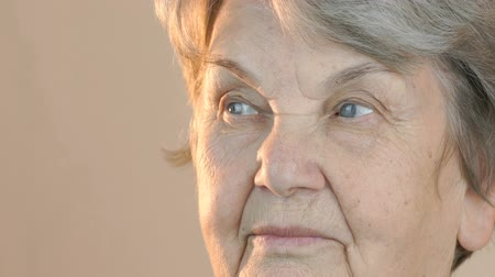 crinkle : Old woman looking in side indoors. Face close up