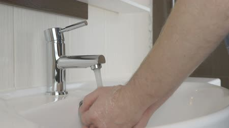 plated : Man washing hands in the bathroom of the hotel Stock Footage