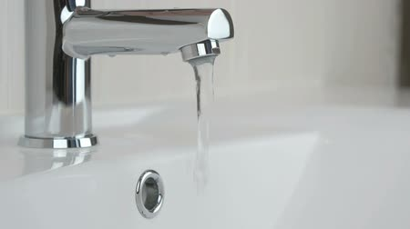 plated : Male hands opening chrome-plated tap for washing hands