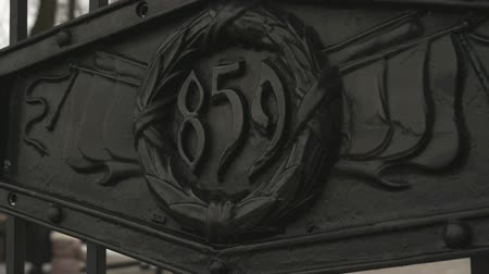 relict : Entrance metal gate with inscription 859. Year of base of Velikiy Novgorod Kremlin, Russia. Close-up Stock Footage