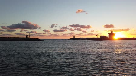 Řím : Ostia Lido Rome, Italy - January 17, 2019: Beautiful sunset at marina emtrance in the Roman coast, it is the tourist port of Rome located in the coastal district of Ostia Lido.
