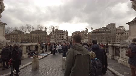 Řím : Rome, Italy - February 03, 2019: A look at SantAngelo Bridge populated by tourists who admire the beauty of ancient Rome Dostupné videozáznamy