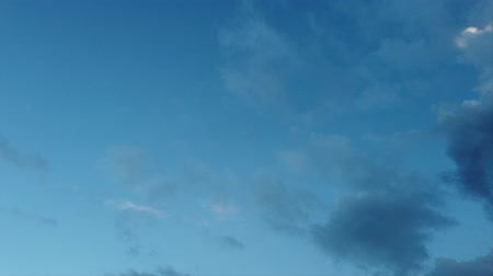 heavenly : Time lapse of dark blue sky with light blue clouds and other evanescent Stock Footage