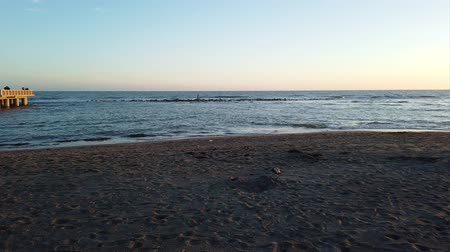 Řím : Ostia Lido Rome, Italy - April 04, 2019: Sunset seascape time lapse motion in Ostia Lido beach, start the view and panoramic view of the shoreline and Roman coast with people walking in beautiful springtimes day