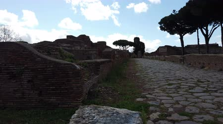 тайна : A look at the past with the beautiful Viale delle Corporazioni in archaeological excavations of Ostia Antica, Rome - Italy