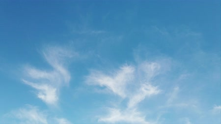 puffy cloud : TIme lapse with soft movement of cirrus clouds in different directions with a beautiful background of blue sky