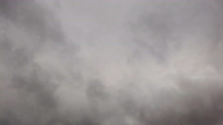 srážky : Timelapse sky with dense gray nimbostratus clouds blow like smoke