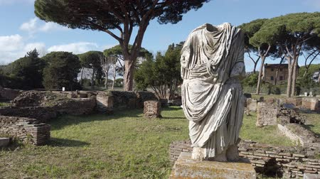 biust : Overview of Roman necropolis Ancient Ostia in Rome with a beautiful ruin of a Roman bust