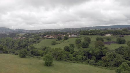 farmhouse : Panoramic aerial view of Italy countryside with farms, country houses, meadows and fruit trees, valley and hills Stock Footage