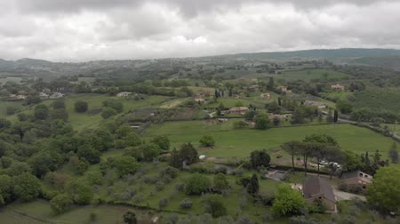 farmhouse : Awesome aerial view of Italy green valleyys countryside and hills, farmhouses and cultivated fields fruit trees and forest