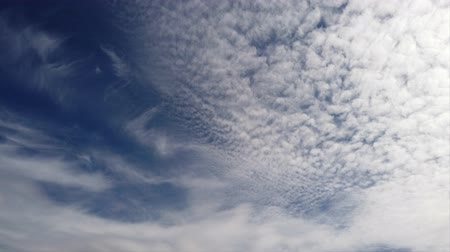 pelyhes : Beautiful time lapse of afternoon blue sky and cirrocumulus clouds carried by the wind
