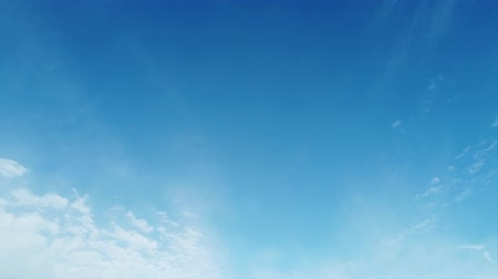 pelyhes : Beautiful time lapse of white cirrocumulus clouds in a light blue summer blue sky