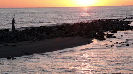 god ray : Relaxing sunset at Roman beach in Ostia Lido coast with scenic pastel-colored Stock Footage