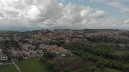 farmhouse : Awesome aerial view of Italian countryside with Rignano Flaminio village amidst meadows, forest and hills in cloudy day