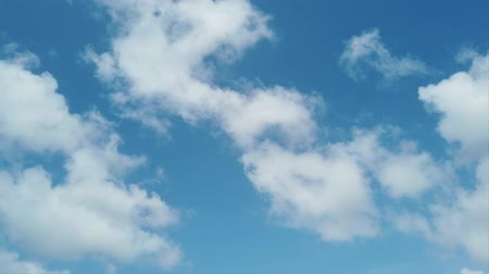 altocumulus : Scenic puffy cumulus clouds flies fast and carefree in a blue summer sky Stock Footage