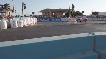 ралли : Rome, Italy - July 21, 2019: At Rome capital city Rally public event, the fast rally car quickly running on the track to the bend