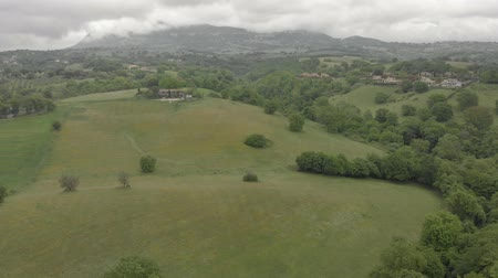 Aerial view - Flying over hilly landscape with green woods and hills Wideo