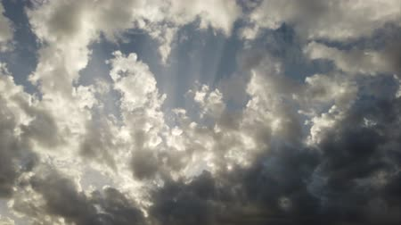 Spectacular cloudy sky with sunbeams and back