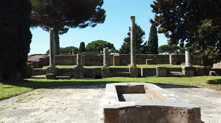 evsahibi : A look at the beautiful Roman ruins in the archaeological excavations of Ancient Ostia, with impluvium, Roman colonnades and remains of buildings Stok Video
