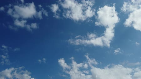 Awesome time lapse until mackerel sky: Puffy white clouds moving fast until beautiful blue sky