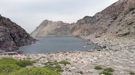 Pan view of european wilderness cove with the suggestive rocky bay of Cala fico located in Sardinia region in Saint Peter island, Italy