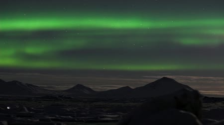 alasca : Green Northern Lights over the Arctic mountains, solar storm