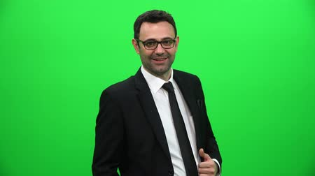 crossed : Young Confident Caucasian Businessman on Green Screen