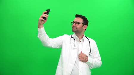 Doctor Taking Selfie on Green Screen Vídeos