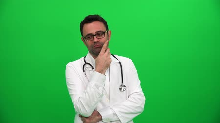 Thinking Doctor on Green Background