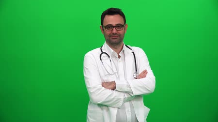 Doctor Looking at Camera on Green Background