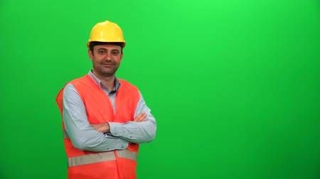 Construction Worker Crossing His Arms and Smiling on Green Screen
