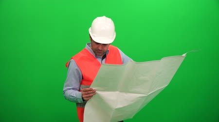 Architect Checking Technical Construction Drawings on Green Background Vídeos