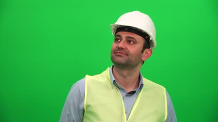 fidedigno : Architect or Construction Worker Looking Up on Green Screen