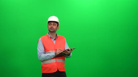 Engineer Preparing Report On A Green Screen