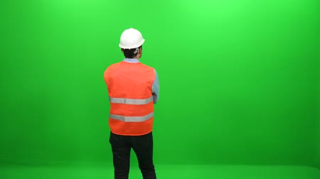 bum : Rear View of  Architect Wearing Helmet on Green Screen