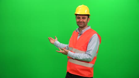Engineer Worker Making Presentation Gestures on Green Screen. Showing Back Side.
