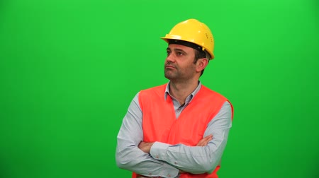 Architect or Construction Worker Looking Up on Green Screen. Right Side.