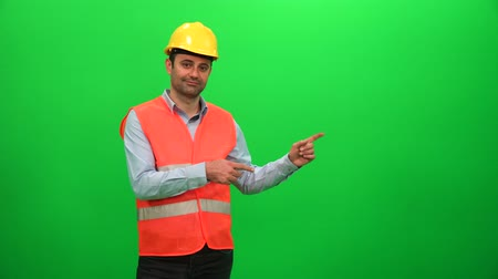 operators : Engineer Worker Making Presentation Gestures on Green Screen. Showing Left Side.